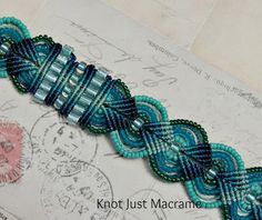 """close up of knotted micro macrame bracelet in shades of teal and turquoise - from """"Knot Just Macramé"""""""