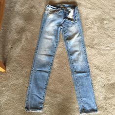 """Super skinny jeans Super skinny= fits bigger than a Jegging but skinnier than skinny jeans. Light vintage blue. Light distress on pockets. Mid rise. Stretch. 32"""" inseam. This style was sold in select stores for a short period of time. American Eagle Outfitters Jeans Skinny"""