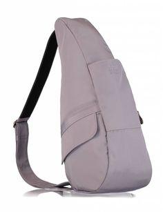 """The Healthy Back bag Microfibre Small lavender Mist  De """"Topper"""" onder de rugtassen en niet in de laatste plaats vanwege de scherpe prijs. Oersterk sportief en modieus is deze rugtas/crossover met veel binnen- en buitenvakken. De tas is ergonomisch: ontworpen om de rug te ontlasten en de druk op de nek en schouders te minimaliseren. De unieke vorm verdeelt het gewicht over de gehele rug. Alle tassen hebben een verstelbare schouderriem met anti-slip. Tevens als schoudertas te dragen. Met de…"""