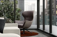 Mad Joker armchair with outer body in leather Nabuk 2 tortora and inner fabric covering Zante 17 melanzana, glossy brown nickel swivel base with spokes.