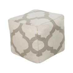 Handmade in India, this square wool pouf features a chic trellis motif and offers an effortless seat for your guests.    Product: