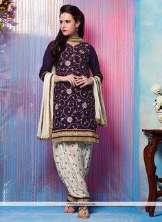 Make the heads flip as soon as you dress up with this purple cotton   patiala suit. Look ravishing clad in this dress that's enhanced embroidered, lace and resham work. Comes with matching bottom and ...