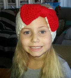 white ear warmer with a red bow is size child-adult small and the head band is size 12months-3years.