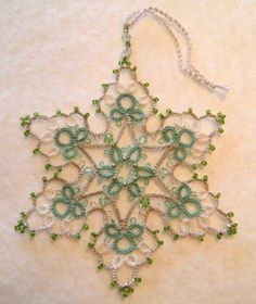 J Stawasz Green & Silver snowflake J Stawasz pattern (modified) from Book 1 Tatting theory & Patterns pg. Tatting Jewelry, Tatting Lace, Beaded Ornaments, Christmas Ornaments, Tatting Tutorial, Snowflake Designs, Tatting Patterns, Book 1, Doilies