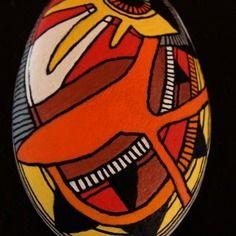 208, galet peint à l'acrylique dans des tons vifs et multicolores.
