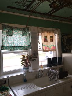 Another no sew curtain, vintage kitchen curtains tied up on nails.