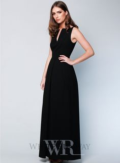 Marcie Tuck Maxi. A gorgeous full length dress by Romance the Label. A high neck style featuring a split in the neckline and folded detailing in the skirt.