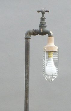 Loving this #industrial looking #light fixture :) THIS is a good #DIY #plumbing project!