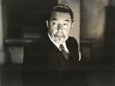 Charlie Chan searches Colby House.Charlie Chan's Secret (1936)