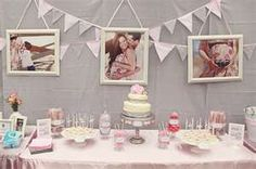 baby shower set up for table with cake-- if they take pregnancy pictures this is super cute!