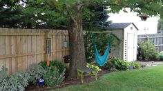 What a charming landscaping vignette with this garden shed! This home is going to sell fast!