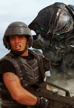 Starship Troopers. This movie scared the hell out of me as a kid, now I think it's hilarious....and a little creepy at times.
