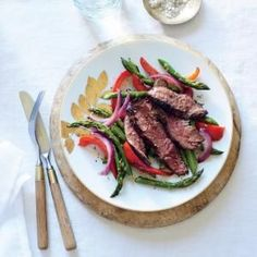 6-ingredient Sizzling Skirt Steak with Asparagus and Red Pepper - Omit oil and sub tamari for the fish sauce. The marinade tenderizes and gives intense flavor to the steak, resulting in a slightly caramelized crust.