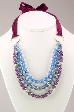 tie ribbon on short necklaces to lengthen them