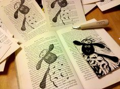 Cut block printing on book pages, cut out for a cool looking design.