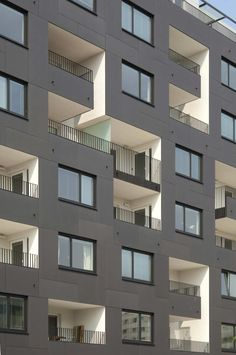 Anthracite EQUITONE facade panels, white loggia's. Appartment block in Vienna by Zechner architects. #architecture www.equitone.com