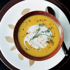 Gingered Butternut Squash Soup with Spicy Pecan Cream | Dean Fearing loves the holiday feel of butternut squash, especially when it's combined with ginger, as it is for his smooth, gently sweet soup.