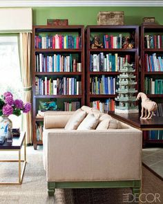 """""""The library's sofa and bookcases are by Todd Hase Furniture."""" Long Island, New York, home of Amy and Todd Hase. Photography by Roger Davies. """"A Hamptons Home With a French Accent"""" by Mitchell Owens. Elle Decor (September 2010)."""