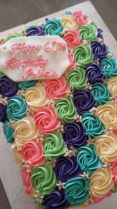 Celebrating a 60th birthday with multi-coloured buttercream roses.