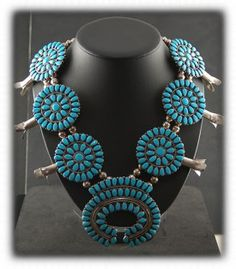 Zuni Native American Jewelry - wonderful old Kingman Turquoise cluster squash blossom from the 1940s.