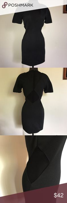 """NastyGal Collection Mesh Cut-Out Dress An amazing slightly stretchy mesh cut out dress from NastyGal. Has only been worn once and is an excellent condition. Has tiny shoulder pads for an extra """"oomph"""" fashion statement and is made from textured thick material so it won't show through where it's not desired and it looks classy because it keeps everything in. The geometrical mesh patterns run through the front, sides and back of the dress. Closes securely with a zipper on the back. Nasty Gal…"""