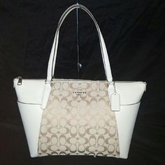 """Coach Signature Leather Shoulder Bag Coach Signature 12cm Ava Tote   DETAILS? Smooth calf leather With Signature Canvas? Two Outside Slip Pockets? Inside zip, cell phone and multifunction pockets? Zip closure, fabric lining? Handles with 9"""" drop? 16 3/4"""" (L) x 9 3/4"""" (H) x 5"""" (W)?  This bag is brand new and will come with the care card inside. The bag was purchased from Coach Factory Outlet. Coach Bags Shoulder Bags"""