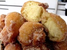 """Homemade doughnuts - Bolinhos de Chuva (which translates to """"little cakes of rain"""") are delicious little cinnamon and sugar doughnut holes. Perfect for breakfast or dessert, these can be made in less than 15 minutes and are AMAZING! Brazilian Dishes, Brazilian Recipes, Brazil Food, Brazil Brazil, Good Food, Yummy Food, Yummy Recipes, Comida Latina, Portuguese Recipes"""