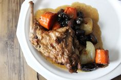 Rabbit Braised with Kalamata Olives and Prunes #SundaySupper Recipe Main Dishes with bacon, cipollini onions, carrots, rabbit, loin, ground black pepper, kosher salt, all-purpose flour, unsalted butter, garlic, dry red wine, chicken stock, fresh thyme, pitted kalamata olives, pitted prunes