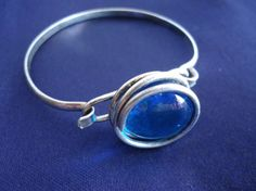 Silver bracelet with blue glass stone by juliesringsandthings
