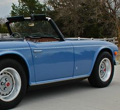 Hit the road in this cobalt blue Triumph with the top down