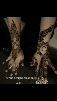 the hand on the right, with fernlike leaves coupled with regular mehndi paterns. cool. The hand on the left is built around an infinity symbol. not bad.