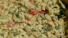In this family favorite, cheesy tortellini is dressed up with tomatoes, mushrooms, spinach, and a rich creamy sauce.