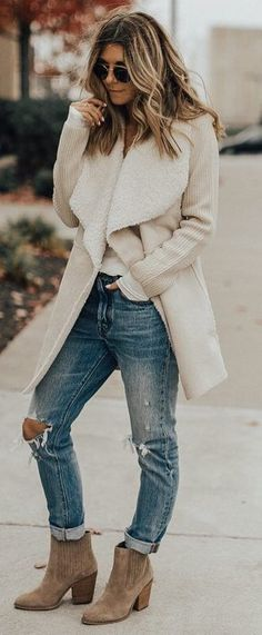 trendy winter outfit / nude coat + ripped jeans + boots + top