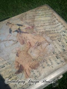 Detail of table top finished with decoupage papers, Annie Sloan Craqueleur & dark wax with gold highlights. -Jeanene Dean of Serendipity Design House Boutique