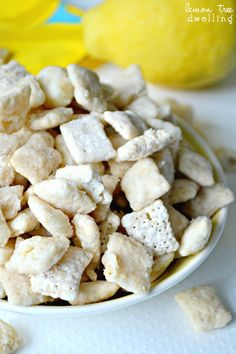 A mix between puppy chow and lemon bars - genius! This easy dessert recipe couldn't be more perfect for summer. Make this Lemon Bar Puppy Chow today.