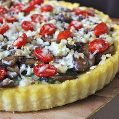 Asiago Spinach, Balsamic Mushrooms, Spicy Grilled Corn and Fresh Cherry Tomatoes atop a hearty Polenta Crust Tart.