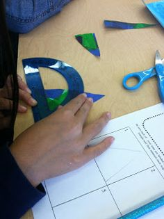 Using a protractor to measure angles on a triangle that the students themselves cut out.