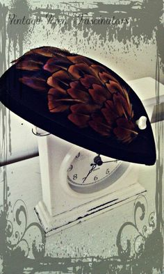 'Elizabeth Woodville' fascinator... Black felt teardrop base with velvet trim. This has been layered with a complimenting shape of tan and black pheasant feathers which have a beautiful pinky/purple sheen in the light. Finished with a vintage faux-pearl button.  Inspired by the beautiful portait of Elizabeth Woodville, Queen consort of England.  £22.50 Elizabeth Woodville, Pheasant Feathers, Black Felt, Fascinators, Vixen, Belle Epoque, Fancy Dress, Different Colors, Art Nouveau