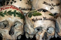 Skulls painted with the name of the deceased.