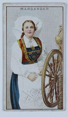 National Costume, Hardanger Card illustrating a colour image of a woman wearing a costume from Hardanger and holding a spinning wheel. Hardanger is a traditional region in west Norway. Norwegian Clothing, Norwegian Fashion, Folk Costume, Costumes, Scandinavian Countries, World Of Color, Spinning Wheels, Colour Images, Traditional Outfits