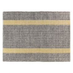 Beautifully textured, the Brecan extra large grey flat weave rug is hand woven with accents of bright yellow stripes, giving your room a smart look.[br]Made from a hand-spun wool/cotton combination, the rug is hard wearing yet soft underfoot.[br]Great for the living or dining room, the rug is part of the Brecan range and is available in a range of sizes.