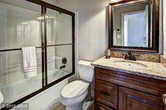 Traditional Full Bathroom with Complex granite counters, tiled wall showerbath, Complex Granite, limestone tile floors, Flush