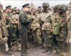 General Dwight D. Eisenhower meeting with men from Co. E, 2nd Battalion, 502nd Parachute Infantry Regiment (Strike) 101st Airborne Division, just before they load up for the drop on Normandy, on the evening of the 5th of June 1944. The majority of the men in this photo were killed or wounded in battle some hours later.
