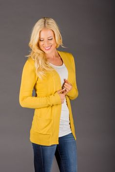 """This perfect fit ribbed cardi has """"take me for a latte"""" written all over it! She features a fitted sleeve, nice long length, POCKETS and an open front. She's super cozy and ready to be layered over your fave tops, and keep you nice and warm all season long!65% Cotton 35% PolyesterSIZING: Model is 5'9"""" wears a 4 and is modeling the smallSmall 0-4Medium 6-8Large 10-12COLORS:MarineCitrusMossYellowGreyBlackCharcoalSandIvoryLight GreyBurgundyNavyOliveCamelBrick"""