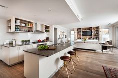 Need more space? Tearing down walls to create open floor plans for living, dining and kitchen areas is what this popular design style is all about.