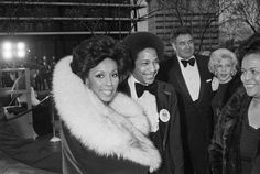 """Diahann Carroll, her mother Mabel Johnson (far right) and her then-husband, Robert DeLeon, a former Managing Editor at Jet magazine, arrive at the Academy Awards on April Ms. Carroll was a Best Actress nominee that year for her role in """"Claudine. Women In History, Black History, Dianne Carroll, Jet Magazine, Magazine Editor, Oscar Fashion, Vintage Black Glamour, Fur Collar Coat"""