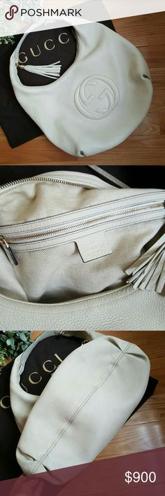 "Gucci White Soho Large Hobo 100% Auth-serious inquiries only please- NO TRADES. Gorgeous pebbled off white leather with light gold hardware and tassel zipper pull. Interlocking Gucci logo on the front. Some signs of wear throughout exterior. Cotton linen lining has some pen marks and inside of interior zipper pocket has some discoloration (could probably be washed out) Overall in excellent pre-loved condition. This will be sent through Posh concierge. Includes dust bag. H12 3/5"" W16 1/5"" D 6…"