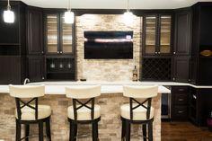 Elaborate Home Wet Bar Design With Dark Cabinetry Light Countertop Island Wine Rack