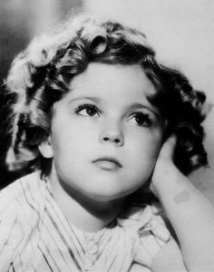 Shirley Temple- I used to love watching her movies when I was little. and now Reagan loves them!:)