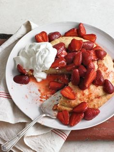 Strawberry Cornmeal Shortcakes | Here, juicy, slightly-sugared strawberries are piled high on buttery shortcake made from cornmeal and cream.